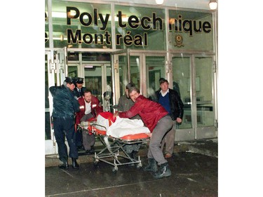 A victim is wheeled away from the Ecole Polytechnique after gunman Marc Lepine opened fire at the school in Montreal on Dec. 6, 1989. Twenty-five years ago, Marc Lepine went on a 20-minute shooting rampage that eventually sparked a national gun-control debate that continues until this day.