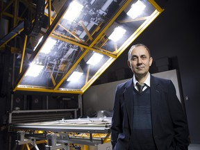 Andreas Athienitis, Ph.D., P.Eng., FCAE and Dept. of Building, Civil and Environmental Engineering Concordia University, with solar simulator at Concordia University.