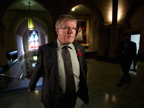 """""""The bathroom that Trans people feel comfortable using now will be the same bathroom they will use after this law (amended) passes,"""" says Senator Don Plett, seen here on Parliament Hill in Ottawa on Monday, Oct.28, 2013."""