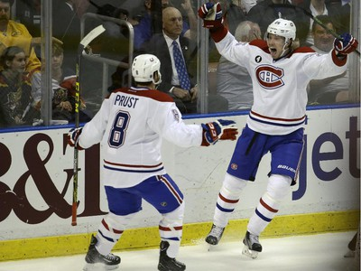 Montreal Canadiens left wing Jacob De La Rose celebrates with right wing Brandon Prust (8) after scoring a goal during the second period Tuesday, March 17, 2015,  in Sunrise, Fla.