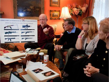 Showing a poster of guns that would not be controlled Jean Francois Laroivee, whose wife was killed at Polytechnique, Jim Edwards, whose daughter Anne Marie was killed at Polytechnique, Louise De Sousa, whose daughter Anastasia was killed at Dawson College, and Suzanne Laplante, mother of Anne-Marie,  were on hand at the Edwars' residence in Pierrefonds in Montreal's west island on Thursday, April 28, 2011, to talk to journalists about the long gun registry , gun control, and their plea to not vote Conservative in the May 2 election.
