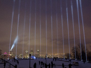 Fourteen beams of light pointing skywards at the Mont Royal Chalet in Montreal, Saturday December 6, 2014.  It was part of a day of commemorations to mark the 25th anniversary of the murder of 14 women at the École Polytechnique, by Marc Lépine.