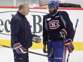 Canadiens coach Michel Therrien talks with defenceman P.K. Subban during practice at the Bell Sports Complex in Brossard on March 13, 2015.