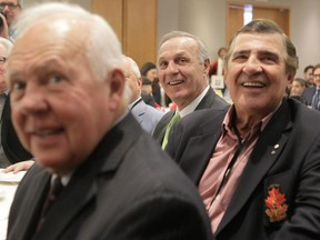 Former Canadiens greats (front to back) Yvan Cournoyer, Serge Savard and Guy Lafleur enjoy the Sports Celebrity Breakfast at the Cummings Centre in Montreal  on Sunday, March 29, 2015.
