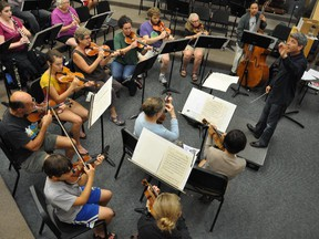 """""""They are all as committed as I am about erasing that stigma of mental illness from society,"""" notes conductor Ronald Braunstein, far right, of Me2 Orchestra's musicians."""