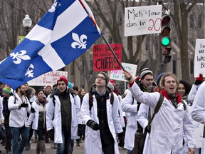 Medical students from four major Quebec universities demonstrate against Bill 20 on health, Monday, March 30, 2015 near the legislature in Quebec City.