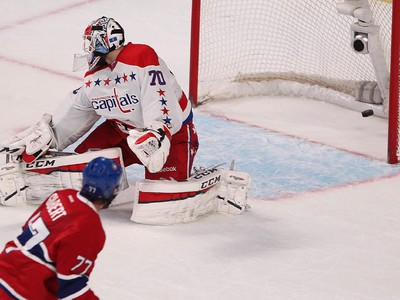 Montreal Canadiens' Tom Gilbert puts the puck past Washington Capitals' Braden Holtby, during second period NHL action in Montreal on Thursday April 2, 2015.