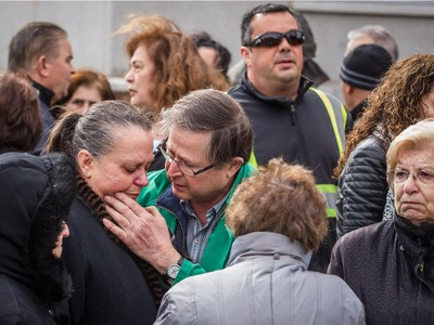 A woman is comforted  at the scene of the overnight fire at the Koimisis Tis Theotokou Greek Orthodox Church, also called Panagitsa,in Parc-Extension April 14, 2015.
