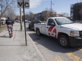 A Bixi pickup truck with a trailer full of bike leaves the scene of an accident involving a cyclist on Sherbrooke St. E. near La Fontaine Park in Montreal Friday, April 17, 2015.