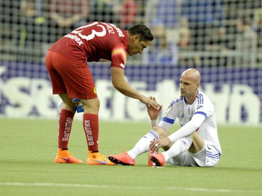 Club America goal keeper Moisés Muñoz consoles Laurent Ciman of the Montreal Impact at the end of the final game of CONCACAF Champions League final between Montreal Impact and Club America from Mexico City in Montreal at the Olympic Stadium Wednesday, April 29, 2015. Club America won.