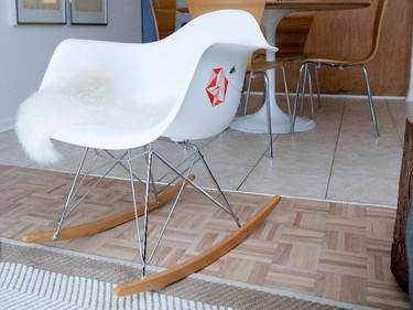 A chair by Charles Eames with added hand painting sits in the living room.