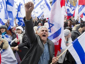 Henry Dahan cheers with others during a celebration of the state of Israel, at Place des Festivals in Montreal, Thursday April 22, 2015.