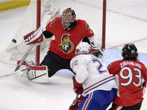Ottawa Senators goalie Craig Anderson makes a save as Montreal Canadiens' Dale Weise (22) and Senators' Mika Zibanejad (93) watch for a rebound during first period Stanley Cup NHL playoff hockey action in Ottawa on Wednesday, April 22, 2015.