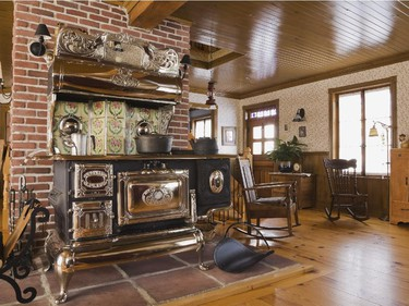 A 1907 Legare's Rural wood burning stove in the kitchen area was restored to its pristine condition by the original owner.
