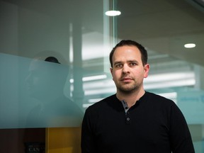 Mike Gozzo, product director of Radialpoint, poses for a photograph at the company offices in Montreal. Gozzo's first startup business, Appifier, had initial success but the company's decline had a heavy toll on his personal life.