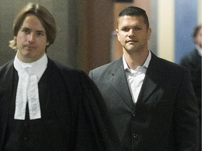 Amir El Alfy, right, and his lawyer Dylan Jones leave Montreal courtroom on Monday May 11, 2015.