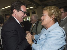 Pierre Karl Péladeau, new elected leader of the Parti Québécois Pierre Karl Peladeau, is greeted by former leader Pauline Marois during a gala dinner on National Patriots' Day in Montreal, Monday, May 18, 2015. Marois's expenses since leaving office in 2014 have reached $129,276.