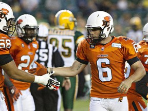 B.C. Lions kicker Ricky Schmitt (6) is congratulated after kicking field goal against the Eskimos during CFL action in Edmonton on  June 13, 2014.