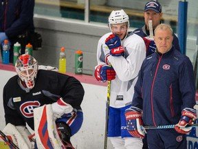 Canadiens head coach Michel Therrien watches players go through practice drill  at the Sports Forum in Tampa, Fla., on May 11, 2015 as they prepare for Game 6 of Eastern Conference semifinal series against the Tampa Bay Lightning.