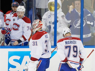 Montreal Canadiens goalie Carey Price, centre, and teammate Andrei Markov, right, skate towards the bench after losing game three of their NHL eastern conference semi-final hockey series against Tampa Bay Lightning at Amalie Arena in Tampa on Wednesday, May 6, 2015.