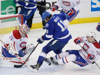 Tampa Bay Lightning centre Brian Boyle, centre, attempts a shot against Montreal Canadiens goalie Carey Price, left, as Canadiens defenceman Alexei Emelin, right, falls during the second period of game three of their NHL eastern conference semi-final hockey series at Amalie Arena in Tampa on Wednesday, May 6, 2015.