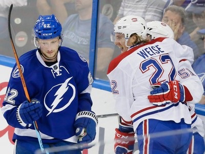 Montreal Canadiens right wing Dale Weise, right, congratulates Montreal Canadiens centre David Desharnais, obscured, for his goal as Tampa Bay Lightning defenceman Andrej Sustr, left, skates past during the second period of game four of their NHL eastern conference semi-final hockey series at Amalie Arena in Tampa on Thursday, May 7, 2015.