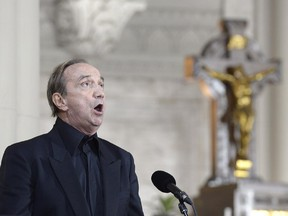 Singer Claude Dubois performs at the the state funeral for former Quebec premier Jacques Parizeau in Montreal on Tuesday, June 9, 2015.