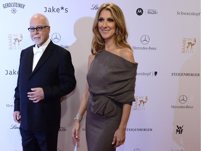 Canadian singer Céline Dion, right,  and her husband Rene Angélil pose for photographers as they arrive on the red carpet for the Bambi awards in Duesseldorf, western Germany, on November 22, 2012. The Bambis are the main German media awards.