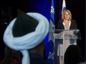 A Muslim man listens to Quebec Public Security Minister Lise Theriault during a news conference to unveil an anti-radicalization strategy, Wednesday, June 10, 2015 in Montreal.