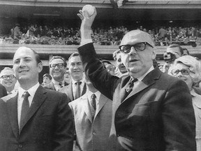 Montreal mayor Jean Drapeau, with Expos owner Charles Bronfman (left), throws out the ceremonial first pitch before the first game in Expos history on April 8, 1969 against the Mets at Shea Stadium in New York.