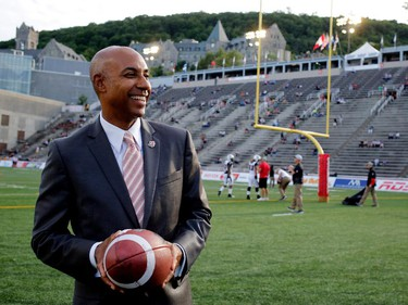 CFL commissioner Jeffrey Orridge visits the Percival Molson Stadium field before the start of the Montreal Alouettes home opener against the Ottawa Redblacks in Montreal on Thursday June 25, 2015.