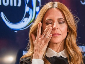 """Television host and producer Julie Snyder wipes a tear as she announces that she is """"abandoning"""" television production during a press conference at the Productions J offices in Montreal on Monday, June 29, 2015. Snyder said it's necessary for her to abandon television production because the Quebec government is refusing to give tax credits to her production company due to her relationship with Parti Québécois leader Pierre-Karl Péladeau."""