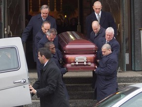 The coffin of alleged underworld figure Salvatore Montagna is carried to a car following his funeral at Notre-Dame-de-Pompéi church Nov. 28, 2011. Montagna was fatally shot in Charlemagne, a suburb just east of Montreal.