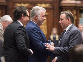 Philippe Couillard, centre, with François Legault and Pierre-Karl Peladeau: at election time, the Parti Québécois and Coalition Avenir Québec will each sell themselves as the credible alternative to the Liberals.