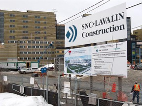 An SNC Lavalin sign displays the company's involvement in the MUHC construction project in Montreal Feb. 27, 2013.
