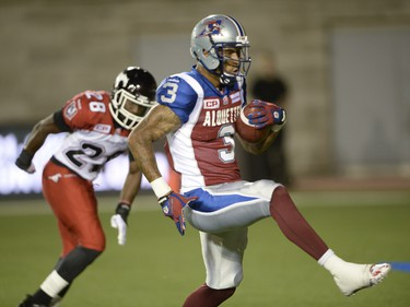 Montreal Alouettes wide receiver Cody Hoffman (3) runs in a touchdown as Calgary Stampeders defensive back Brandon Smith (28) looks on during second half CFL football action in Montreal, Friday July 3, 2015. THE CANADIAN PRESS/Ryan Remiorz