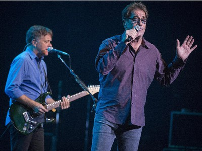 Huey Lewis and guitarist Chris Hayes perform during their concert at Salle Wilfrid-Pelletier of Place des Arts during the Montreal International Jazz Festival in Montreal, on Wednesday, July 1, 2015.
