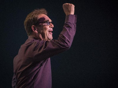 Huey Lewis pumps his fist during the opening number as he performs in concert at Salle Wilfrid-Pelletier of Place des Arts during the Montreal International Jazz Festival in Montreal, on Wednesday, July 1, 2015.