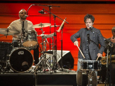 jazz-pop singer and songwriter Jamie Cullum plays the drums during the opening number at Maison symphonique de Montréal during the Montreal International Jazz Festival in Montreal, on Wednesday, July 1, 2015.