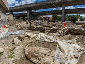 Quebec archaeologists are searching an area about the size of a football field at the corner of St-Jacques and St-Rémi Sts. in Montreal, on Friday, July 31, 2015.