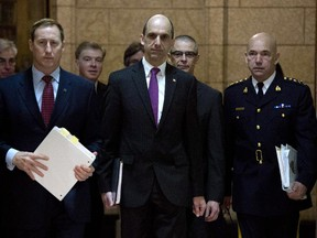 Justice Minister Peter MacKay (left), Public Safety and Emergency Preparedness Minister Steven Blaney, CSIS director Michel Coulombe and RCMP Commissioner Bob Paulson arrive at the Commons public safety committee hearing witnesses on Bill C-51, Anti-terrorism Act on Parliament Hill in Ottawa, Tuesday March 10, 2015.