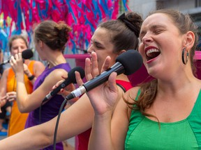 As part of The Public Pianos of Montreal in Tune event, the all-girl group VoxA4 paid tribute to French singer Edith Piaf on Victoria St. in Montreal, on Thursday, August 20, 2015y. Left to right, Élodie Miron, Luce Bélanger, Anne-Marie Pilon, Marie-Eve Villemure during their lunch-hour performance.