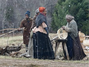 """Background actors are seen during filming of """"The Book Of Negroes"""" in Cole Harbour, N.S., on Monday, April 28, 2014. One of the most devastating ways that Canada has denied its own history of anti-black racism is through a narrative of benevolence that overshadows the human agency of black struggle, Rachel Zellars writes."""