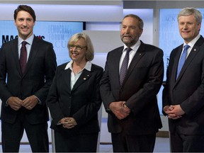 Party leaders Justin Trudeau, Liberal Party; Elizabeth May, Green Party; Thomas Mulcair, NDP; and Stephen Harper, Conservative Party, prior to the first  leaders' debate August 6, 2015 in Toronto.