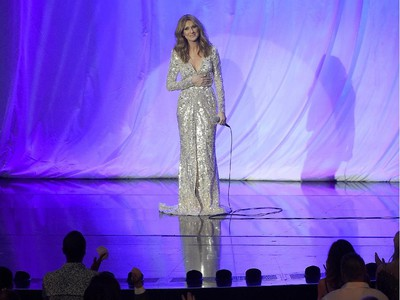 Singer Céline Dion gets a standing ovation as she takes the stage at The Colosseum at Caesars Palace to resume her residency on August 27, 2015 in Las Vegas, Nevada. The show had been on hiatus since August 2014 when Dion stopped performing to care for her ailing husband René Angélil.