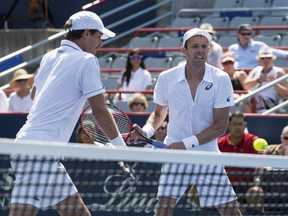 Daniel Nestor watches his doubles partner Édouard Roger-Vasselin, of France, return to Bob Bryan and Mike Bryan, of the United States, during the men's doubles final at the Rogers Cup tennis tournament Sunday August 16, 2015 in Montreal.