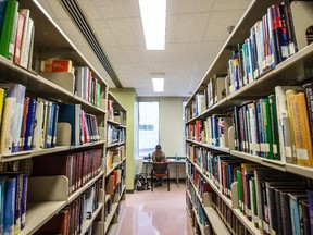 A woman studies at the library inside the McGill University Faculty of Medicine McIntyre Medical Building.