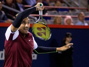 Nick Kyrgios returns ball to Stan Wawrinka  during Rogers Cup action in Montreal on Aug. 12, 2015.