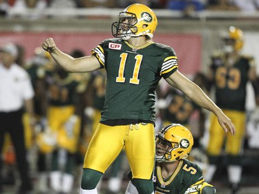 Edmonton Eskimos kicker Grant Shaw and holder Jordan Lynch watch Shaw's game winning field goal on the last play of the game during Canadian Football League action against the Alouettes in Montreal Thursday August 13, 2015.