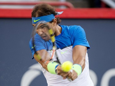 Rafael Nadal, of Spain, returns to Mikhail Youzhny, of Russia, during round of sixteen play at the Rogers Cup tennis tournament on Thursday, August 13, 2015, in Montreal.